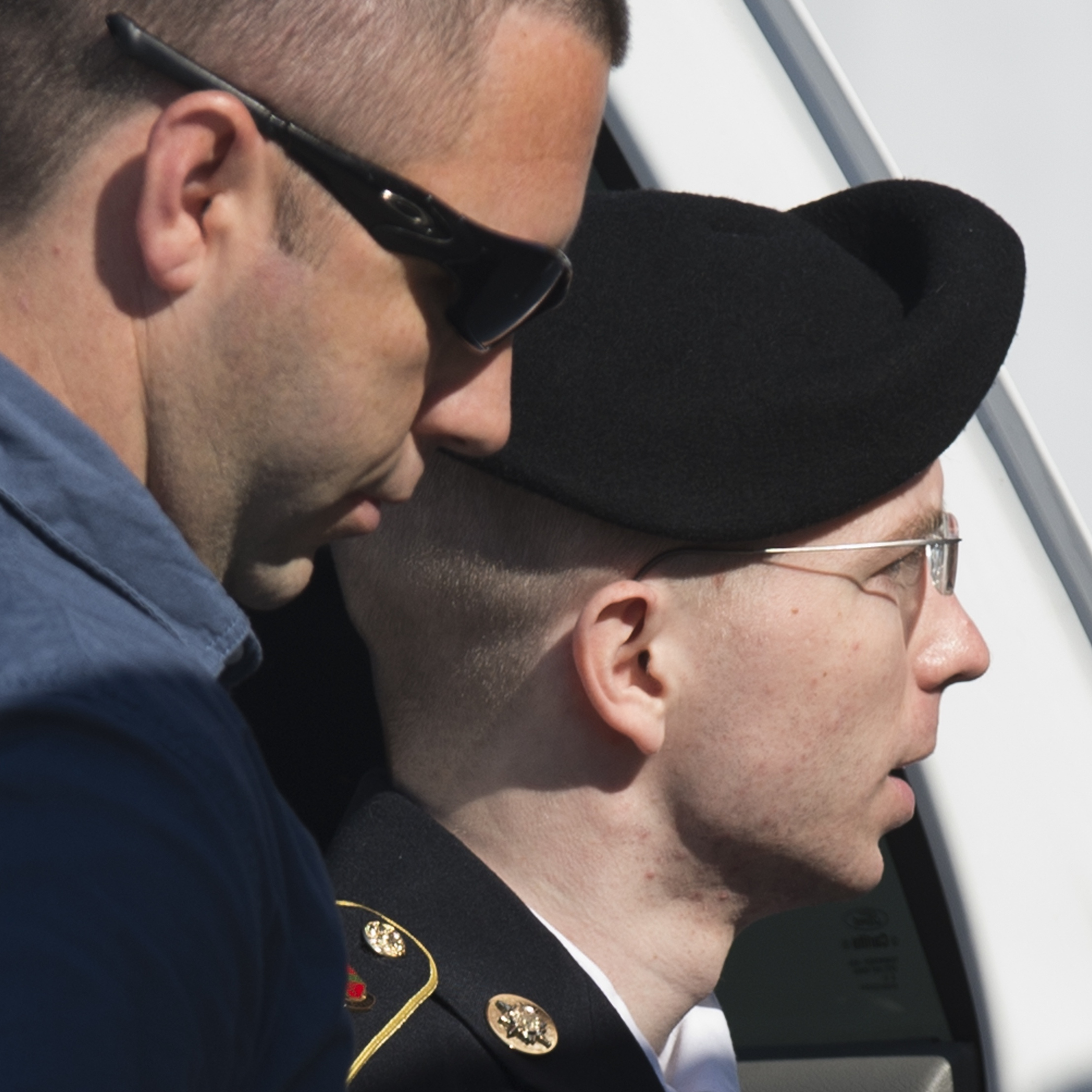 Army Pfc. Bradley Manning arrives alongside a military official at a U.S. military Magistrate Court facility Tuesday for the verdict in his trial at Fort Meade, Md.
