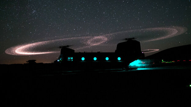 Dust lights up the rotors of a CH-47 Chinook helicopter as paratroopers with 3rd Squadron, 73rd Cavalry Regiment load for an air assault mission near Combat Outpost Ab Band, May 23, 2012, Ghazni province, Afghanistan.