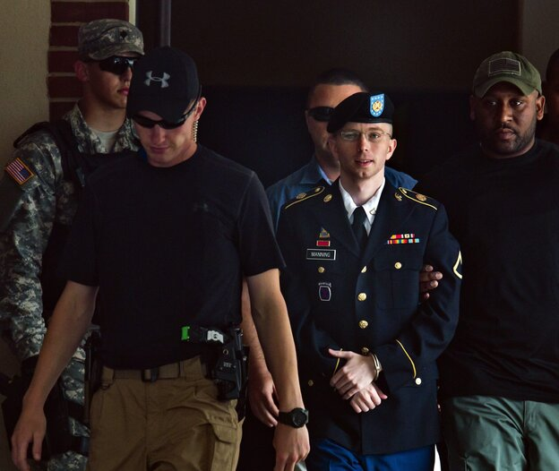 Army Private Bradley Manning, center, leaves the courtroom at Fort Meade, Maryland, on Tuesday.