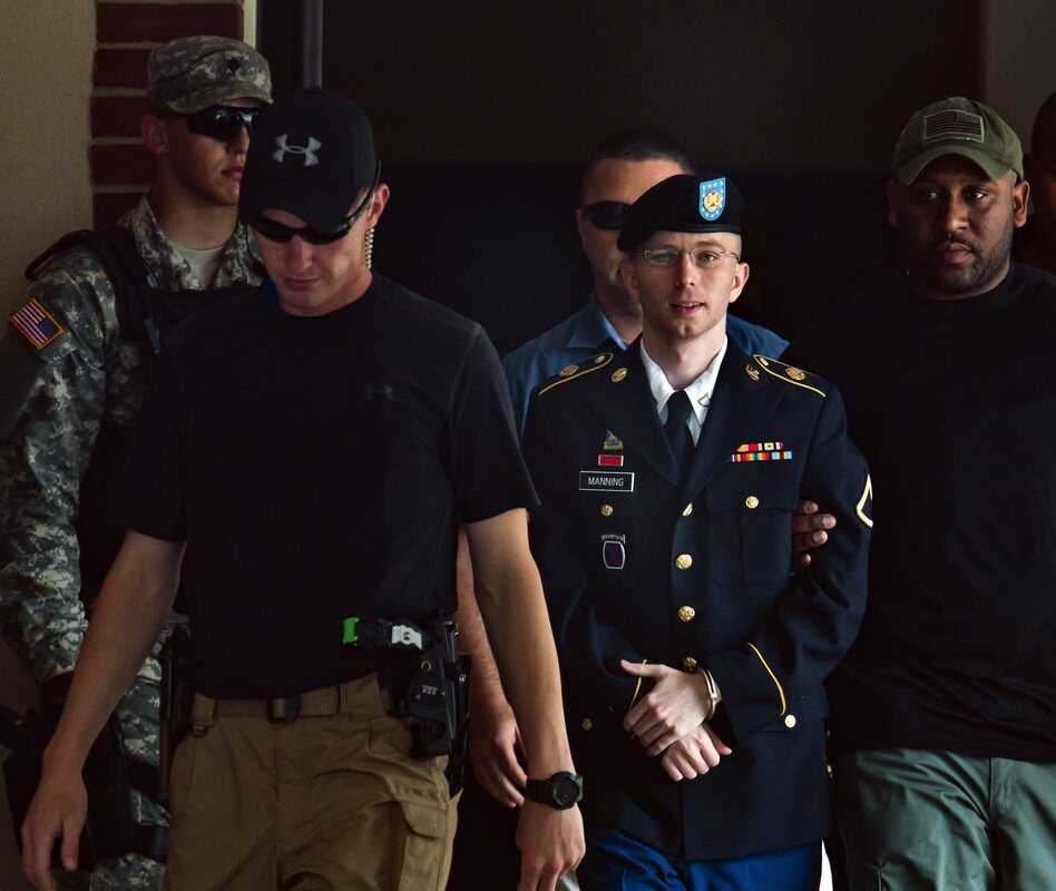 Army Private Bradley Manning, center, leaves the courtroom at Fort Meade, Maryland, on Tuesday. (Jim Lo Scalzo/EPA /Landov)