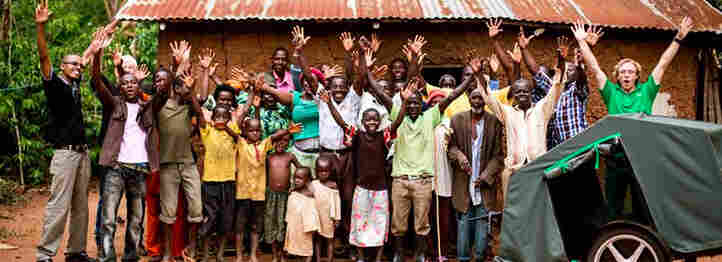 Local villagers, health workers, AIDS orphans and CA Bikes staffers celebrate the delivery ofa bike ambulance  to Barr Village in northern Uganda.