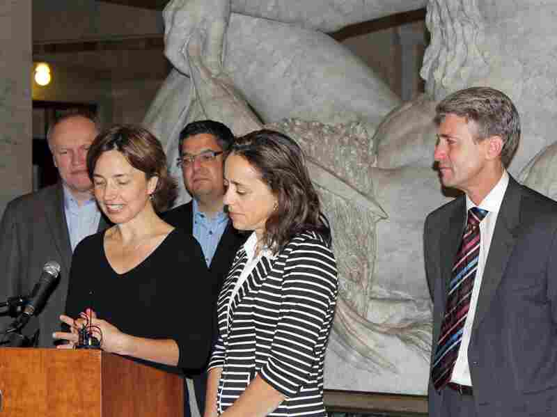 Cathy ten Broeke speaks during a news conference last month at Minneapolis City Hall. She and her partner, Margaret Miles (right), along with Jeff Isaacson (back left) an