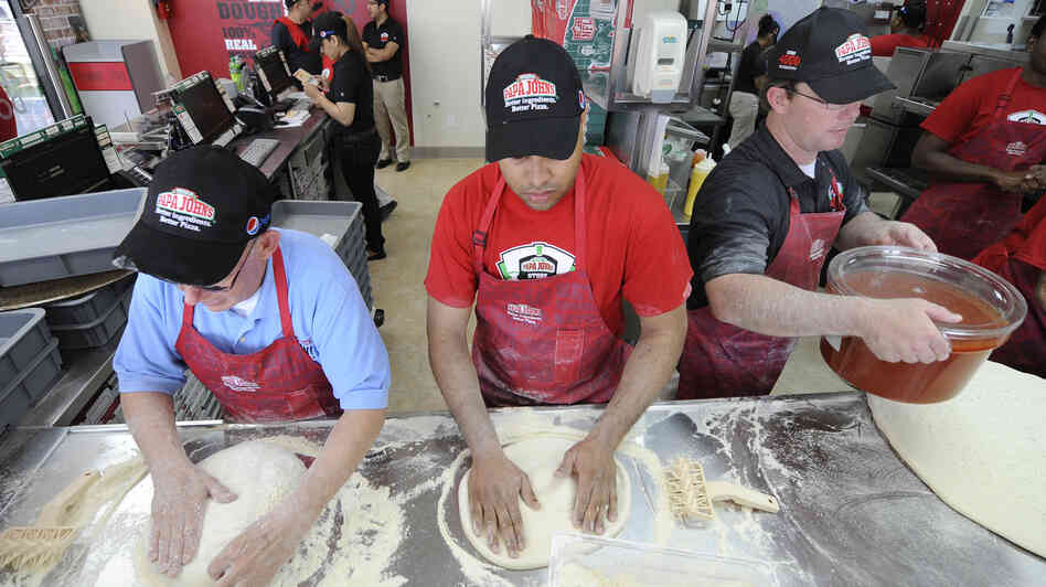 Employees at a papa john s in new hyde park n y make pizzas in 2012