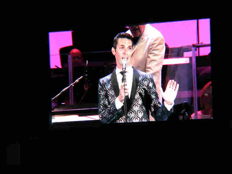 "The Hollywood Bowl is so large it requires Jumbotron-like screens for a good view of the show. Here is full-size Ari Shapiro, singing ""Yo Te Quiero Siempre."""