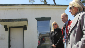 Sen. Bill Nelson, D-Fla., talks to reporters outside the so-called White House at the closed Dozier School for Boys in March, with University of South Florida forensic anthropologist Erin Kimmerle (at left) and Wansley Walters, secretary of the Florida Department of Juvenile Justice.