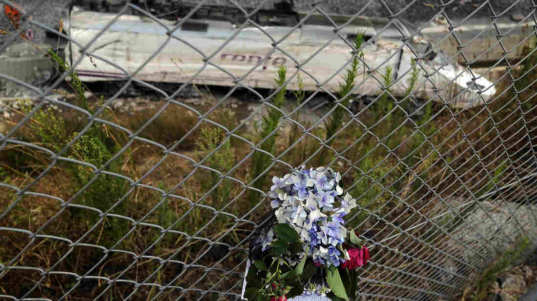 Flowers pay tribute to the victims of the train that crashed in northwestern Spain last week. The driver of the train was on the phone and traveling at nearly twice the speed limit, according to court papers.