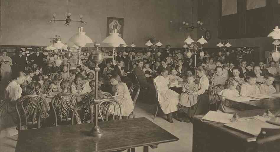 Patrons in the reading room of the Carnegie Library of Homestead in Munhall, Pa., circa 1900. The Carnegie Steel Co.fought back against striking steel workers in Homestead in 1892. Click here to see a larger view of this image.