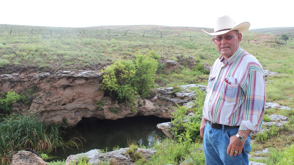 Nate Pike fears that wells, like this one that supplies his ranch with water, will dry up completely after years of water pumping and irrigation in Kansas. (KCUR)