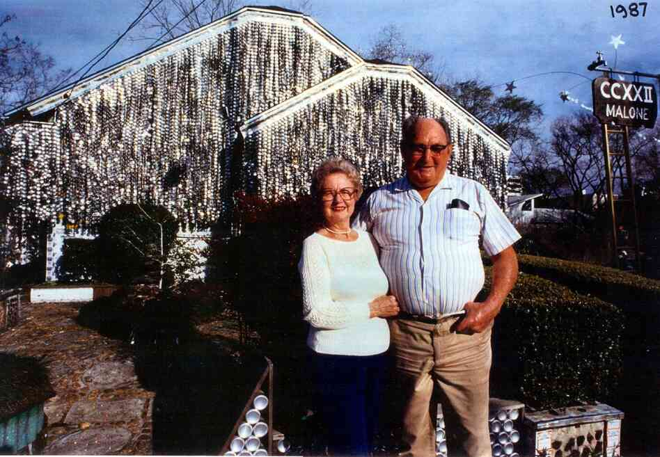 John and Mary Milkovisch in front of their Beer Can House, in Houston in 1987.