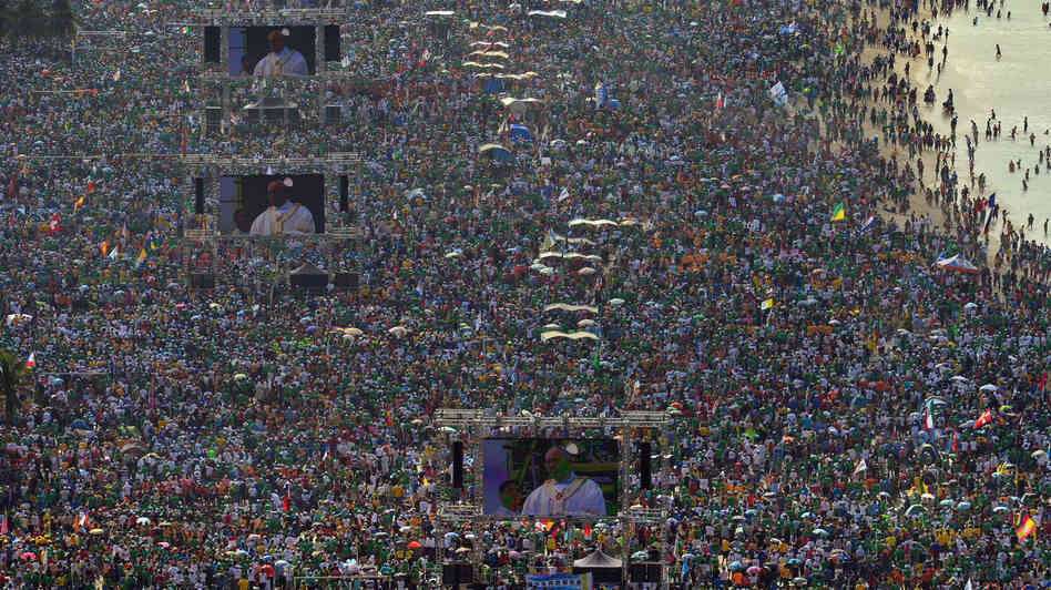 Hundreds of thousands of people crowd Copacabana Beach in Rio de Janeiro on Sunday as Pope Francis celebrates the final Mass of his visit to Brazil. Security lapses, traffic chaos and other logistical snafus marred the vi