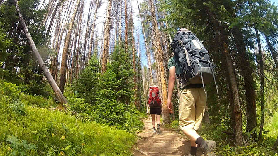 All in the name of science: Volunteers hike in Colorado during their one-week hiatus from electrical lighting.
