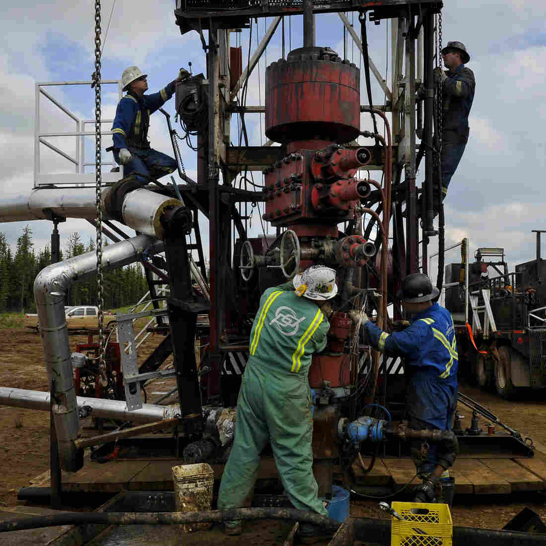 Roughnecks build a drilling rig at the MEG Energy site near Fort McMurray, Alberta, Canada. In addition to large, open-pit mining operations, tar sands oil can be extracted from the ground by pumping down high-pressure steam.
