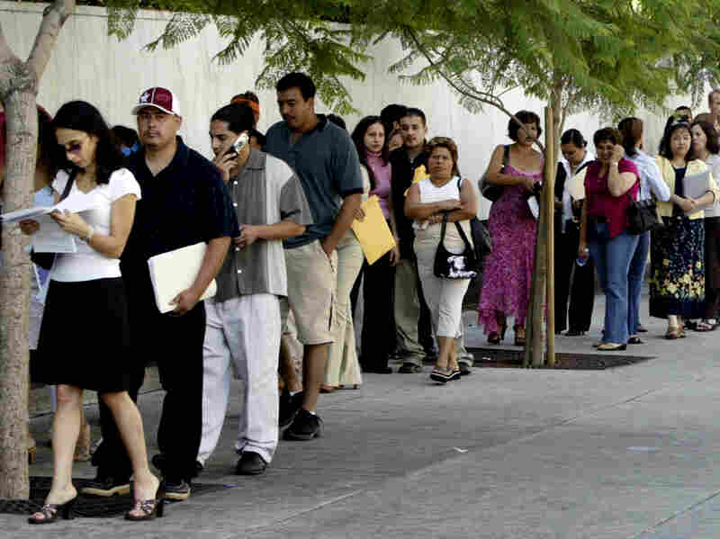 A line waits outside the U.S. Citizenship and Immigration Services office in Los Angeles.