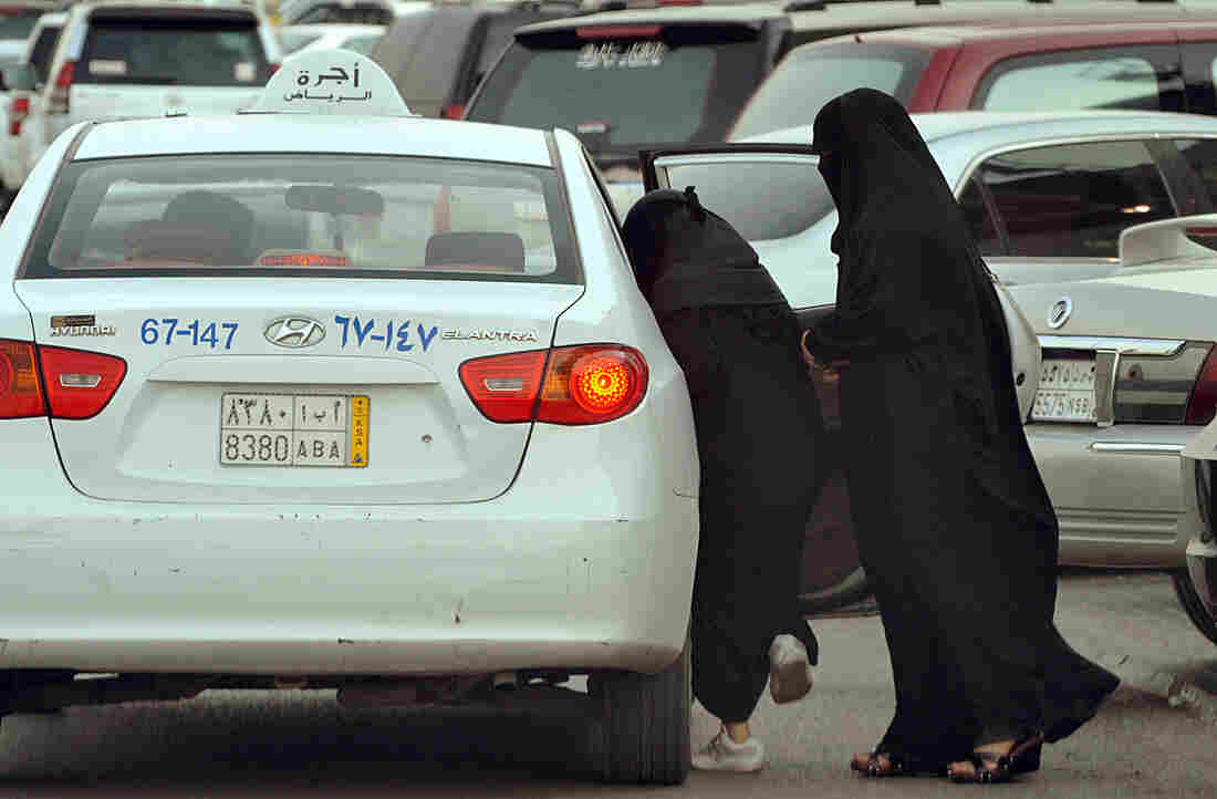 Saudi women get into a taxi outside a shopping mall in Riyadh in 2012. Plans for a subway system in the Saudi capital are likely to provide the biggest benefits to women and the poor.
