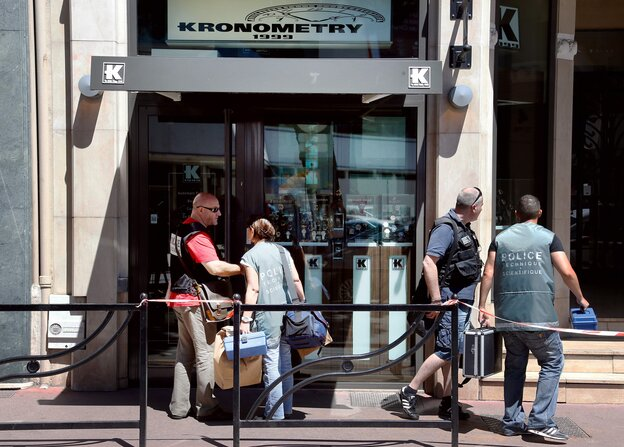 Police investigate outside the Kronometry shop in the French Riviera town of Cannes after two armed men robbed the luxury watch store on Wednesday.