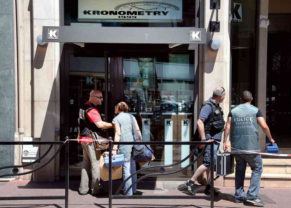 Police investigate outside the Kronometry shop