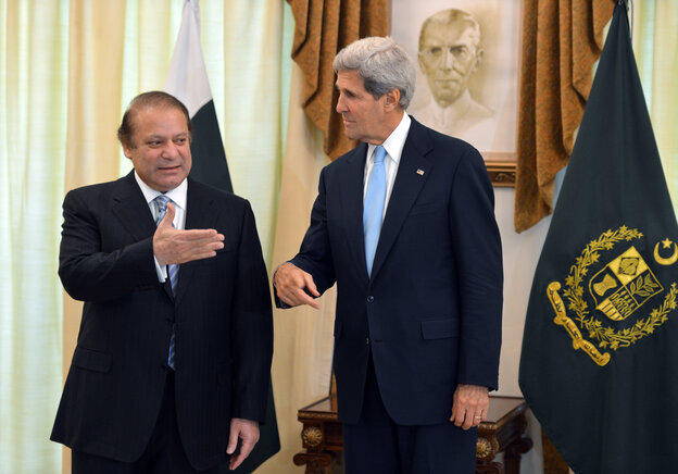 Secretary of State John Kerry speaks with Pakistani Prime Minister Nawaz Sharif at the Prime Minister's House in Islamabad on Thursday.