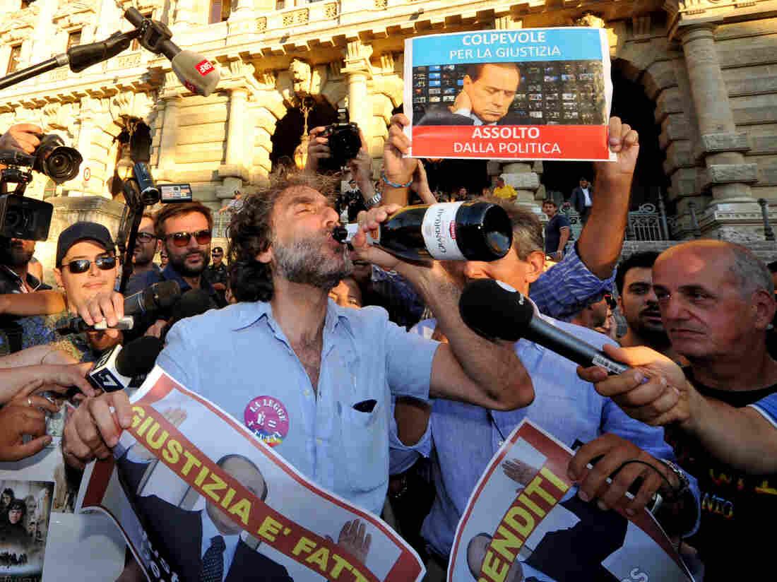 Celebrations in Rome after the Italian Supreme Court's sentencing of Italian politician Silvio Berlusconi on Thursday.