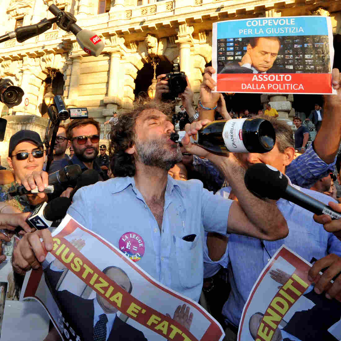 Celebrations in Rome after the Italian Supreme Court's sentencing of Italian politician Silvio Berlusconi on Thursday.