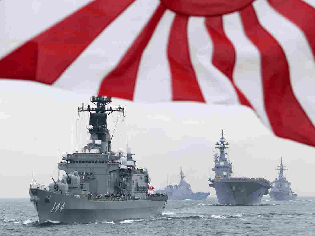 Japan's Maritime Self-Defense Force escort ship Kurama leads other vessels during a fleet review amid heightened tension last year over the disputed Senkaku/Diaoyu islands.
