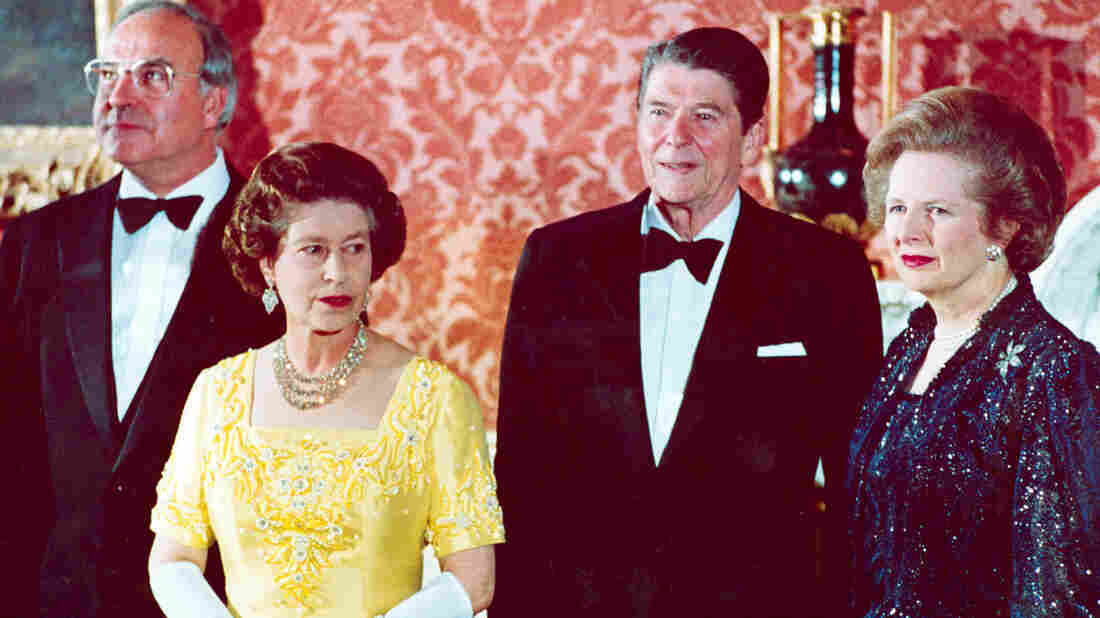 Britain's Queen Elizabeth II (second left) stands with West German Chancellor Helmut Kohl (left), U.S. President Ronald Reagan and Britain's Prime Minister Margaret Thatcher at London's Buckingham Palace on June 10, 1984.