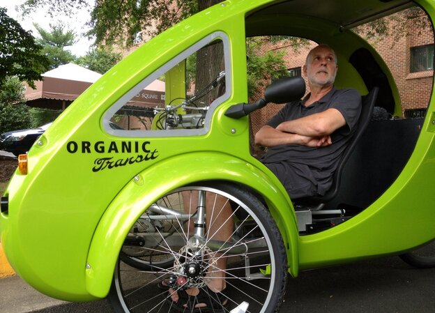 In a photo taken on July 24, ELF bike owner Mark Stewart discusses the unusual vehicle during his tri