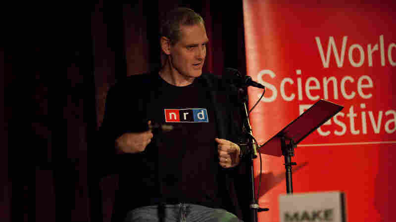 "Puzzle guru John Chaneski rocks his famous ""nrd"" shirt at the World Science Festival taping of Ask Me Another at The Bell House in Brooklyn."