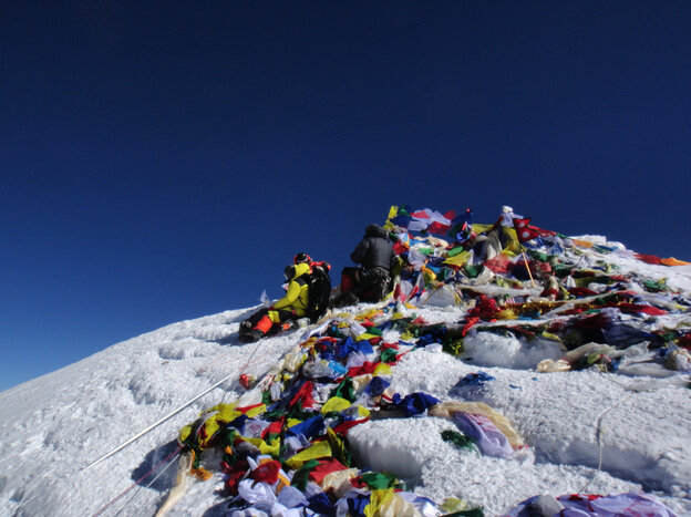 Mountaineers on the summit of Mount Everest in May.
