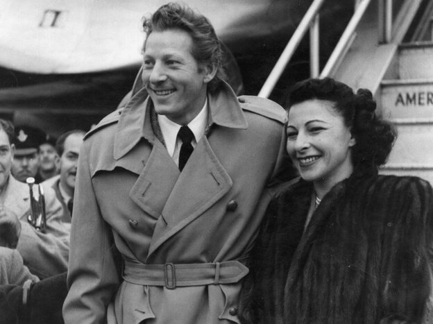 Danny Kaye arrives at London Airport with his wife, Sylvia Fine Kaye, in 1948.