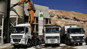 Cement mixers in Rawabi, a planned Palestinian town in the West Bank, about 25 miles north of Jerusalem.