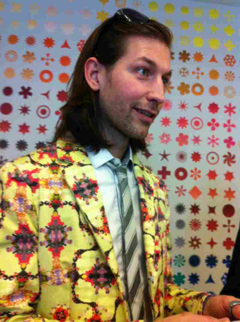 One of the best outfits at the exhibit wasn't actually part of the show: Museumgoer Aaron Peterman designed and made this suit, with its pattern of legendary drag queens on a sunny yellow background.