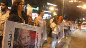 "Activists from a group called ""Third Square,"" which promotes a middle way in the rift between the Muslim Brotherhood and supporters of the army's overthrow of Egyptian President Mohammed Morsi, shout slogans as they gather to oppose both parties at Sphinx Square in Giza on July 30."