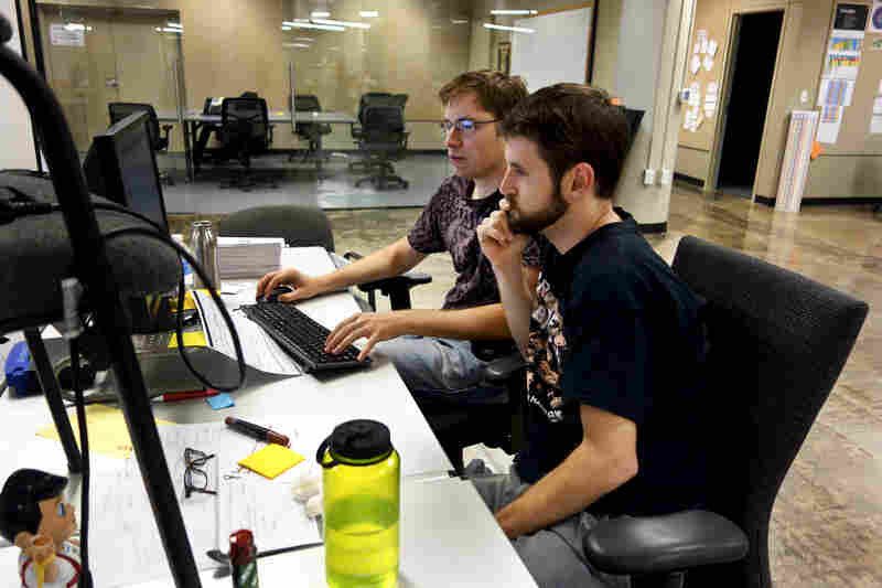 "Menlo developers ""pair programming"" — two coders to a machine with one manning the keyboard."