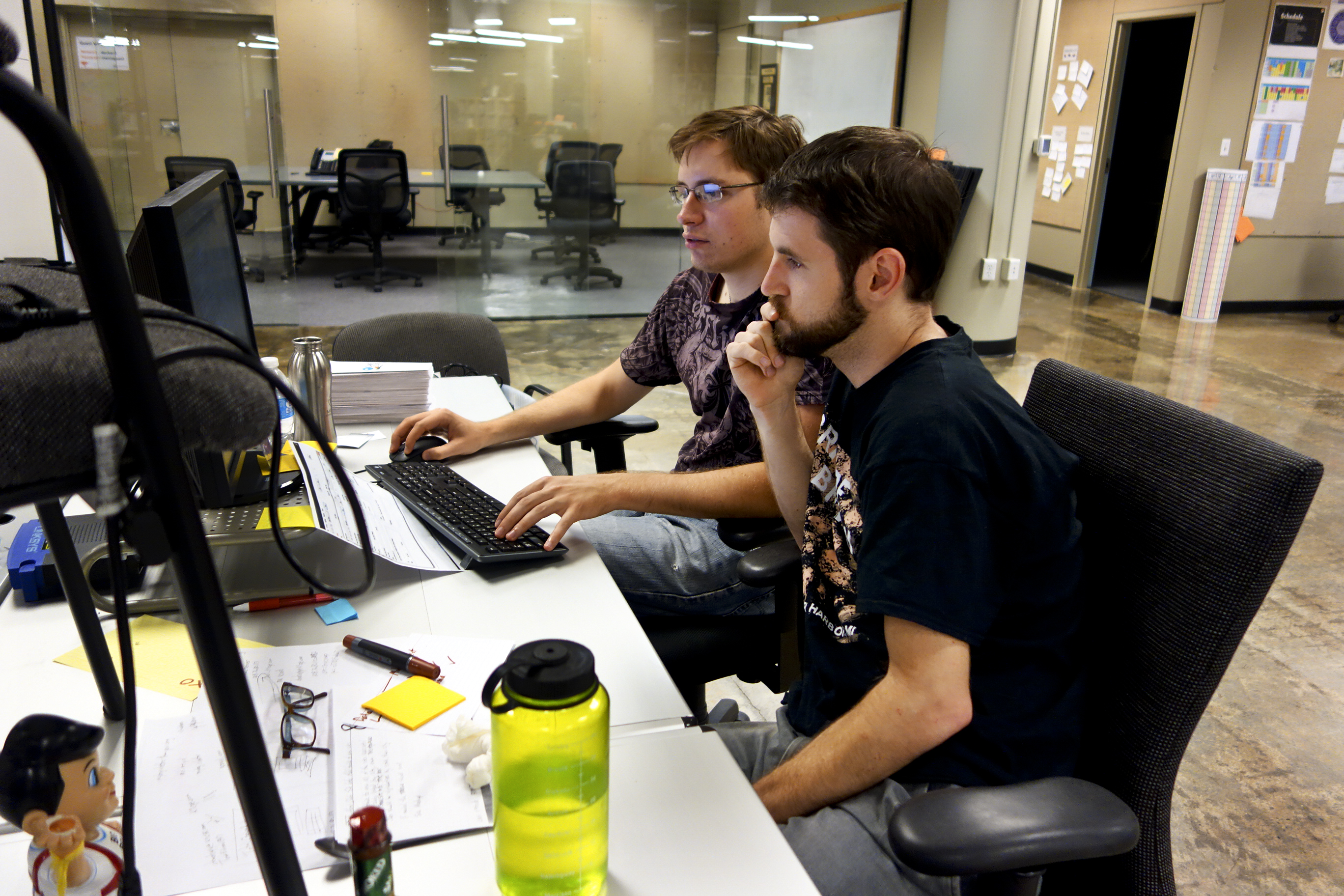"Menlo developers ""pair programming"" -- two coders to a machine with one manning the keyboard."