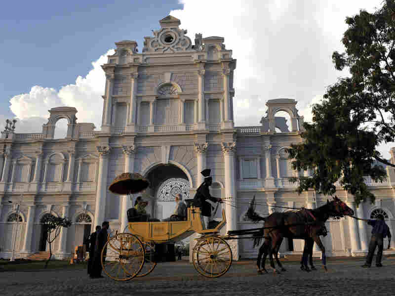 "Visitors ride in a carriage at the entrance of the Jewel of the Nizams ""Falaknuma Palace,"" the former residence of Nizam Mehaboob Ali Khan in the old city area of Hyderabad. The legacy of these Muslim rulers — and the disenfranchisement of the Hindu majority — contributed to the economic gap in Andhra Pradesh."