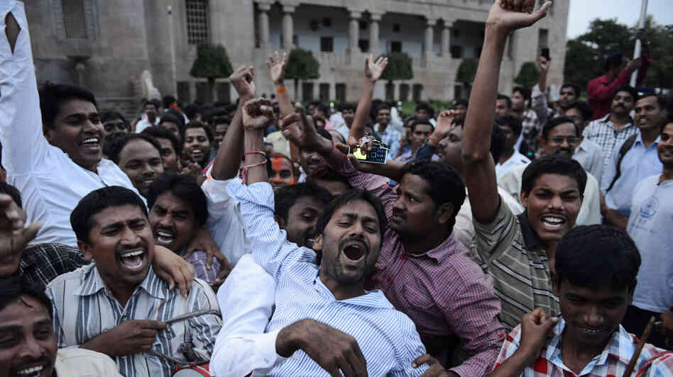 In Hyderabad, Osmania University students celebrate the announcement of the separate Indian state of Telangana, on July 30. India's ruling Congress Party approved a resolution earlier that day to create the new state, amid fears that the decision could spark violence in the region.