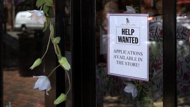 America's unemployment rate sank to 7.4 percent in July, the Bureau of Labor Statistics says. A hiring sign is seen in a store window in Alexandria, Va. (Getty Images)