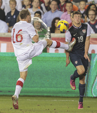 Summing up how the U.S. men started the year, Joshua Gatt (right) takes a boot to the chest from Canada's Matthew Stinson during a 0-0 draw in January.