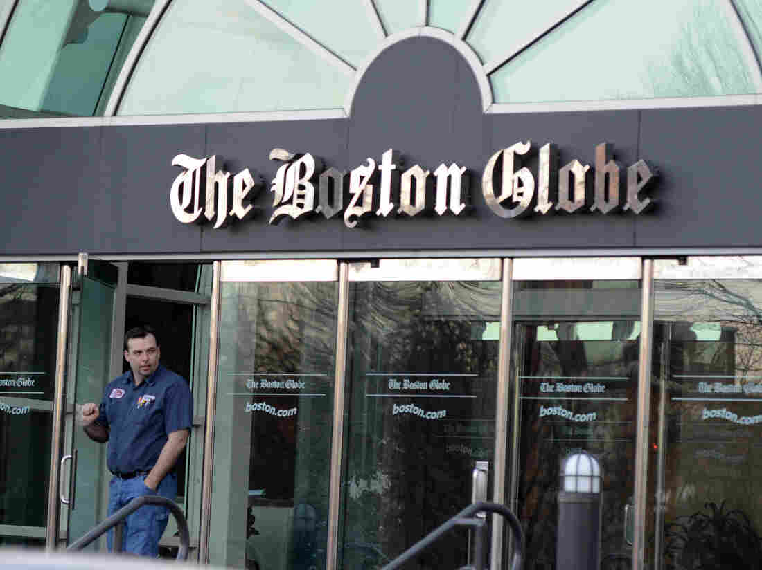 A man walks out of The Boston Globe headquarters on Feb. 20, the day The New York Times Co. said it planned to sell the paper.
