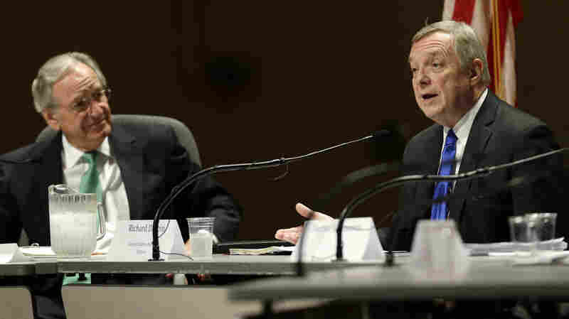 Sen. Tom Harkin (D-Iowa) listens as Sen. Dick Durbin (D-Ill.) speaks at a forum on immigration in Ames, Iowa, on Friday.