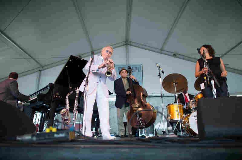 Bill Charlap's elegant trio is crashed by a clarinet summit when veteran reedman Bob Wilber (left of center) and Anat Cohen (right) join in.