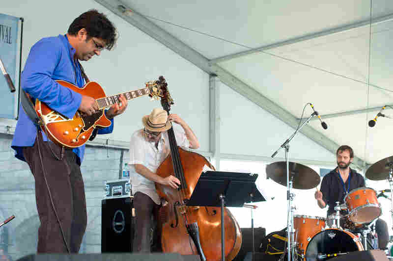 Guitarist Rez Abbasi takes inspiration from the late drummer Paul Motian in an electronics-enhanced trio at Newport.