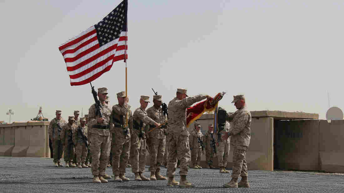Regimental Combat Team 7 cases its flag during their mission's closing ceremony in Helmand Province, Afghanistan.