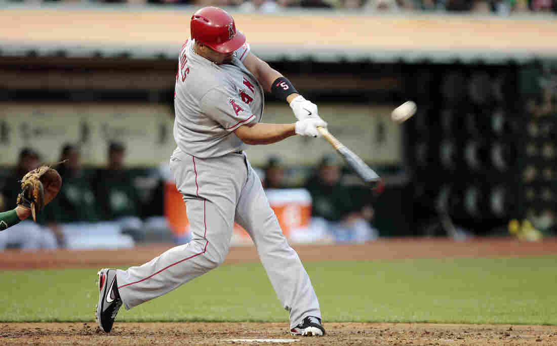 According to author David Epstein, hitters like the Los Angeles Angels' Albert Pujols look at the movement of the pitcher's shoulder, torso or hand to help them hit the ball.