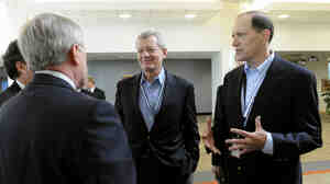 Senate Finance Committee Chairman Sen. Max Baucus, D-Mont., (center) and House Ways and Means Committee Chairman Rep. Dave Camp, R-Mich., (right) s
