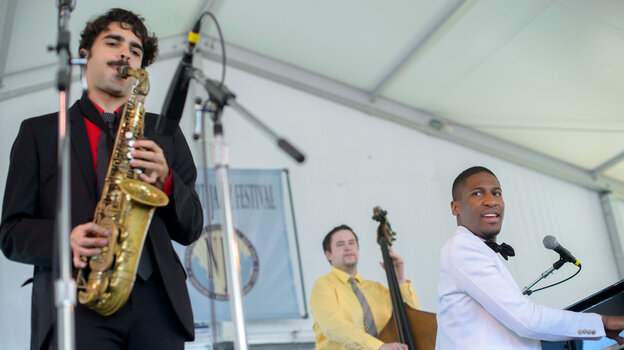 Jon Batiste and Stay Human perform at the 2013 Newport Jazz Festival.