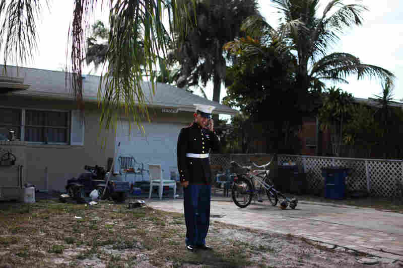 """""""I wanted to visit my mom, but you're not allowed to leave the country while on your leave,"""" Victor says in front of his home in Bonita Springs, Fla."""