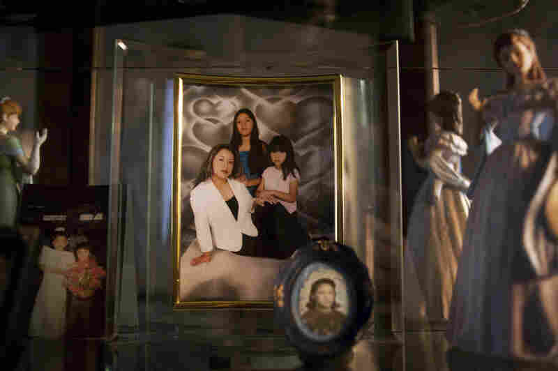 """A framed picture of Lily with her two girls at her home in Bend, Ore. Lily left the picture and her kids — Brian, Ashley and Karleen — with a relative when she was deported to Mexico. """"No quiero que sufren,"""" she said. """"I don't want them to suffer."""""""