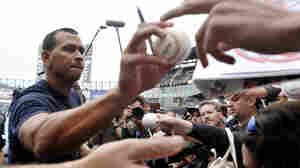 New York Yankees' Alex Rodriguez, left, signs autographs at U.S. Cellular Field before a baseball game against the Chicago White Sox in Chicago on Monday.