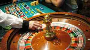 ATLANTIC CITY, NJ - JULY 8: The roulette wheel spins at Caesars Atlantic City July 8, 2006 in Atlantic City, New Jersey. Caesars, along with Atlantic City's 11 other casinos reopend this morning after they were forced to close their gambling floors for the first time in their 28-year history due to the New Jersey state budget impasse. (Photo by William Thomas Cain/Getty Images)
